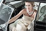 Portrait of Glamourous Woman in a 1964 Chevrolet Imperial LeBaron Stock Photo - Premium Rights-Managed, Artist: Michael Mahovlich, Code: 700-03295279