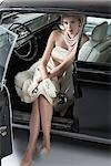 Portrait of Glamourous Woman in a 1964 Chevrolet Imperial LeBaron Stock Photo - Premium Rights-Managed, Artist: Michael Mahovlich, Code: 700-03295280