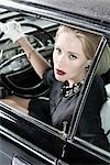 Portrait of Glamourous Woman in a 1964 Chevrolet Imperial LeBaron Stock Photo - Premium Rights-Managed, Artist: Michael Mahovlich, Code: 700-03295284