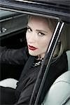 Portrait of Glamourous Woman in a 1964 Chevrolet Imperial LeBaron
