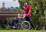 woman in wheelchair with family Stock Photo - Premium Royalty-Free, Artist: Aflo Relax, Code: 649-03296015