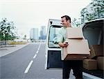 A courier delivering parcels Stock Photo - Premium Royalty-Free, Artist: Masterfile, Code: 649-03297641