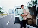 A courier delivers Parcels Stock Photo - Premium Royalty-Free, Artist: Michael Eudenbach, Code: 649-03297642