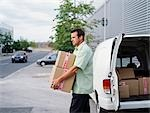 A courier delivers parcels Stock Photo - Premium Royalty-Free, Artist: Michael Eudenbach, Code: 649-03297660