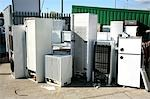 Fridge refuse. Refrigerators and freezers left at a household refuse disposal site to be recycled. Stock Photo - Premium Royalty-Free, Artist: Sheltered Images, Code: 679-03298292