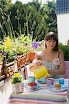 Woman Having Breakfast on Outdoor Balcony Stock Photo - Premium Rights-Managed, Artist: Klick, Code: 700-03298861