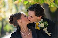 Bride and Groom Kissing, Salzburg, Salzburger Land, Austria Stock Photo - Premium Rights-Managednull, Code: 700-03299229