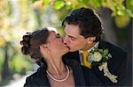 Bride and Groom Kissing, Salzburg, Salzburger Land, Austria Stock Photo - Premium Rights-Managed, Artist: Bettina Salomon, Code: 700-03299229