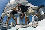Sailors operating windlass on yacht, low angle view Stock Photo - Premium Royalty-Free, Artist: Westend61, Code: 693-03299350