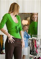 Woman Looking at Clothing in Store Mirror Stock Photo - Premium Royalty-Freenull, Code: 693-03299496