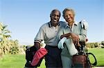 Senior couple in golf course, smiling, (portrait) Stock Photo - Premium Royalty-Free, Artist: Aflo Sport, Code: 693-03299575
