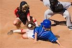 Softball player sliding into home plate Stock Photo - Premium Royalty-Free, Artist: Masterfile, Code: 693-03299618