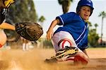 Softball player sliding into home plate Stock Photo - Premium Royalty-Free, Artist: Masterfile, Code: 693-03299621