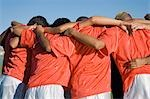 Soccer team in huddle, back view Stock Photo - Premium Royalty-Free, Artist: Aflo Sport               , Code: 693-03299635