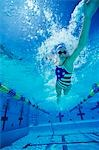 Woman swimming underwater, (low angle view) Stock Photo - Premium Royalty-Freenull, Code: 693-03299705
