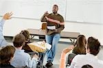Teacher with students in classroom Stock Photo - Premium Royalty-Free, Artist: Ikon Images, Code: 693-03299769