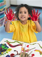 finger painting - Girl finger painting in art class, elevated view Stock Photo - Premium Royalty-Freenull, Code: 693-03300726