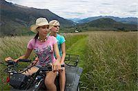 riding crop - Two women riding four-wheeler through field Stock Photo - Premium Royalty-Freenull, Code: 693-03301078