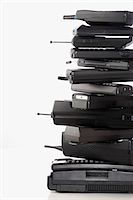 Pile of wireless phones Stock Photo - Premium Royalty-Freenull, Code: 693-03301348