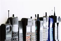 Row of mobile phones Stock Photo - Premium Royalty-Freenull, Code: 693-03301349