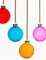 Four Christmas baubles on white background Stock Photo - Premium Royalty-Freenull, Code: 693-03302126