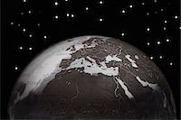 Globe against starry sky, cropped Stock Photo - Premium Royalty-Freenull, Code: 693-03303023