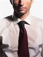 sweaty businessman - Sweaty Young Businessman, mid section Stock Photo - Premium Royalty-Freenull, Code: 693-03303427