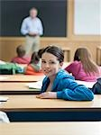 Student in lecture room, portrait Stock Photo - Premium Royalty-Free, Artist: Ikon Images, Code: 693-03305207