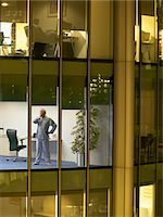 Male surgeon standing in office, view from building exterior Stock Photo - Premium Royalty-Freenull, Code: 693-03305974