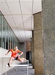 Woman jumping hurdles outside building Stock Photo - Premium Royalty-Free, Artist: ableimages, Code: 693-03308159