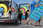 Father and two children (6-11) unloading beach accessories from car Stock Photo - Premium Royalty-Free, Artist: Cusp and Flirt, Code: 693-03309313