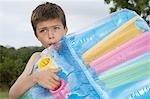 Boy (10-12) blowing up air mattress Stock Photo - Premium Royalty-Free, Artist: Marie Blum, Code: 693-03309379