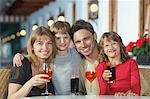 Parents and children (7-9) with drinks at restaurant, portrait Stock Photo - Premium Royalty-Free, Artist: foodanddrinkphotos, Code: 693-03309579