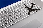 Shadow of jumbo jet over apple macintosh keyboard Stock Photo - Premium Royalty-Free, Artist: Steve Craft, Code: 693-03312128