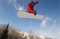 Teenage snowboarder jumping Stock Photo - Premium Royalty-Freenull, Code: 693-03312351