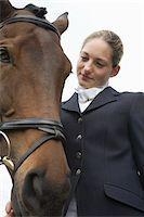 Female horseback rider with horse, outdoors Stock Photo - Premium Royalty-Freenull, Code: 693-03314589