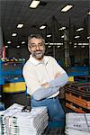 Cheerful man standing in factory, with newspapers Stock Photo - Premium Royalty-Free, Artist: Susan Findlay, Code: 693-03315415