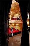 Theatre, view through stage curtain Stock Photo - Premium Royalty-Free, Artist: Robert Harding Images, Code: 693-03316989