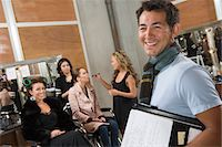 Stage manager backstage with models in hair styling Stock Photo - Premium Royalty-Freenull, Code: 693-03317134