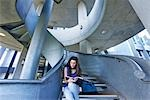 University student reading on staircase Stock Photo - Premium Royalty-Free, Artist: R. Ian Lloyd, Code: 693-03317298