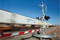 Train passing level crossing, motion blur Stock Photo - Premium Royalty-Freenull, Code: 693-03317575