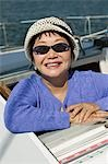 Woman wearing sunglasses on sailboat, (portrait) Stock Photo - Premium Royalty-Freenull, Code: 694-03318227