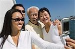 Family photographing themselves on sailboat Stock Photo - Premium Royalty-Freenull, Code: 694-03318249