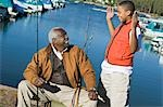 Grandfather and grandson fishing, boy gesturing Stock Photo - Premium Royalty-Free, Artist: Cusp and Flirt, Code: 694-03318933
