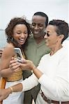 Three Friends Using Cell Phone on Yacht Stock Photo - Premium Royalty-Free, Artist: Blend Images, Code: 694-03319049