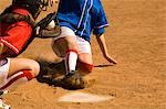 Softball player sliding into home plate, low section Stock Photo - Premium Royalty-Free, Artist: Brian Pieters, Code: 694-03319163