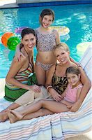 seniors woman in swimsuit - Mother, grandmother and two girls on deck chair by swimming pool, portrait Stock Photo - Premium Royalty-Freenull, Code: 694-03327230
