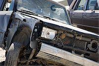 Damaged car in junkyard Stock Photo - Premium Royalty-Freenull, Code: 694-03328696