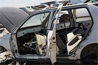 Damaged car in junkyard Stock Photo - Premium Royalty-Freenull, Code: 694-03328699