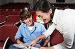 Teacher explaining something to male student Stock Photo - Premium Royalty-Free, Artist: Blend Images, Code: 694-03328885